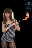 Young woman with a gas torch Stock Image
