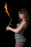 Young woman with a gas torch Royalty Free Stock Images