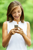 Young woman gathers message Royalty Free Stock Photography