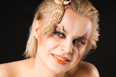 Young woman with Gekko. Portrait of young woman with Gekko gecko stock photo