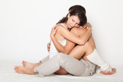 Young woman gently pressed boyfriend Royalty Free Stock Photography