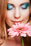 Young woman with gerber flower Royalty Free Stock Photography
