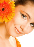 Young woman with gerber flower Stock Photography
