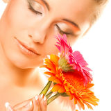 Young woman with gerber flower Stock Photos