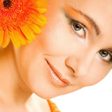 Young woman with gerber flower Stock Photo