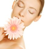Young woman with gerber flower Stock Images