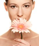 Young woman with gerber flower Royalty Free Stock Photos