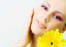 Young woman with gerbera flower. Stock Photos