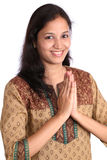 Young woman with gesture of Namaste Royalty Free Stock Photos