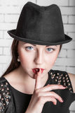 Young woman gestures silently, hush Royalty Free Stock Image