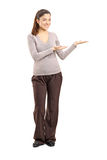 Young woman gesturing. Full length portrait of a young woman gesturing  against white background Stock Photo