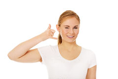 Young woman gesturing call me sign Royalty Free Stock Photography
