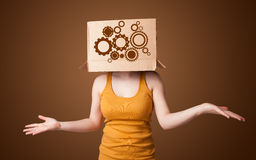 Young woman gesturing with a cardboard box on his head with spur Stock Photos