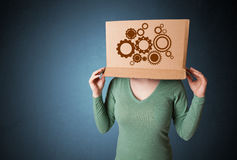 Young woman gesturing with a cardboard box on his head with spur Stock Photography