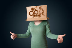 Young woman gesturing with a cardboard box on his head with spur Stock Image