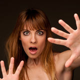Young woman gesturing fear Royalty Free Stock Photos