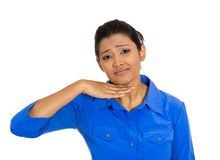 Young woman gesturing with hand to stop talking, cut it out Royalty Free Stock Photo
