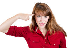 Young woman gesturing with her finger against her temple, are you crazy? Royalty Free Stock Photos