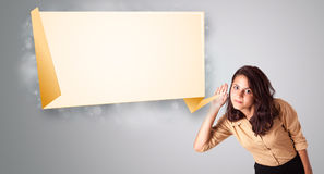 Young woman gesturing with modern origami copy space. Attractive young woman gesturing with modern origami copy space Royalty Free Stock Photography