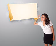 Young woman gesturing with modern origami copy space Stock Photos