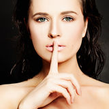 Young Woman Gesturing for Quiet or Shushing Stock Photography