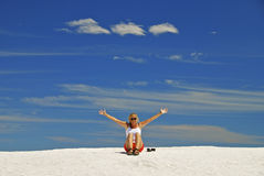 Young Woman Gesturing On Sand Dunes Royalty Free Stock Image