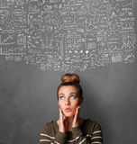 Young woman gesturing with sketched charts above her head Royalty Free Stock Photos