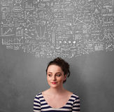 Young woman gesturing with sketched charts above her head Royalty Free Stock Photo