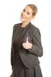 Young woman gesturing thumbs up Stock Photos