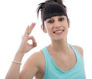 Young woman gesturing to approve  on white background Royalty Free Stock Images