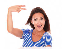 Young woman gesturing a victory sign Stock Photo