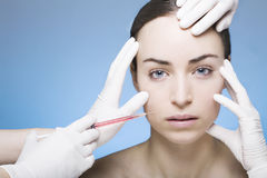 Young woman gets a botox injection Stock Photo