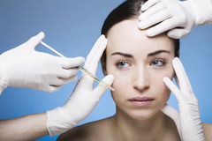 Young woman gets a botox injection Royalty Free Stock Image