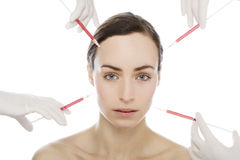 Young woman gets botox injection Royalty Free Stock Photos