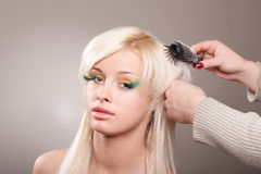 Young woman gets a hairdo Royalty Free Stock Photography
