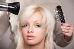 Young woman gets a hairdo Stock Image