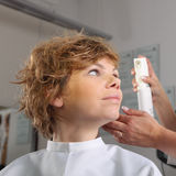Young woman gets a hairdo in the beauty- Royalty Free Stock Image