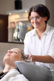 Young woman gets a hairdo in the beauty-shop Stock Photography