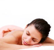Young woman gets a massage. Royalty Free Stock Photography