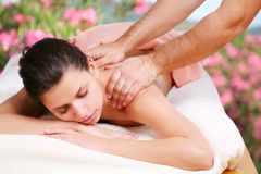 Young woman gets a massage stock photos