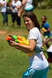 Young Woman Gets Squirted In Water Gun Fight Royalty Free Stock Images