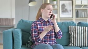 Young Woman getting Angry on phone stock footage