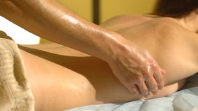 Young woman getting a back massage stock footage