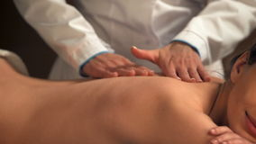Young woman getting back massage in spa salon stock video