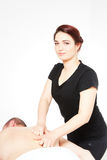 Young woman getting back massage Stock Images