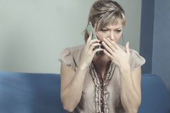 Young Woman Getting Bad News By Phone Royalty Free Stock Image