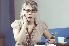 Young woman getting bad news by phone. Young woman getting bad news by phone royalty free stock photos
