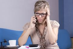 Young woman getting bad news by phone. Young woman getting bad news by phone stock photos