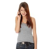 Young woman getting bad news by phone Royalty Free Stock Photography