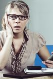 Young woman getting bad news by phone stock photography